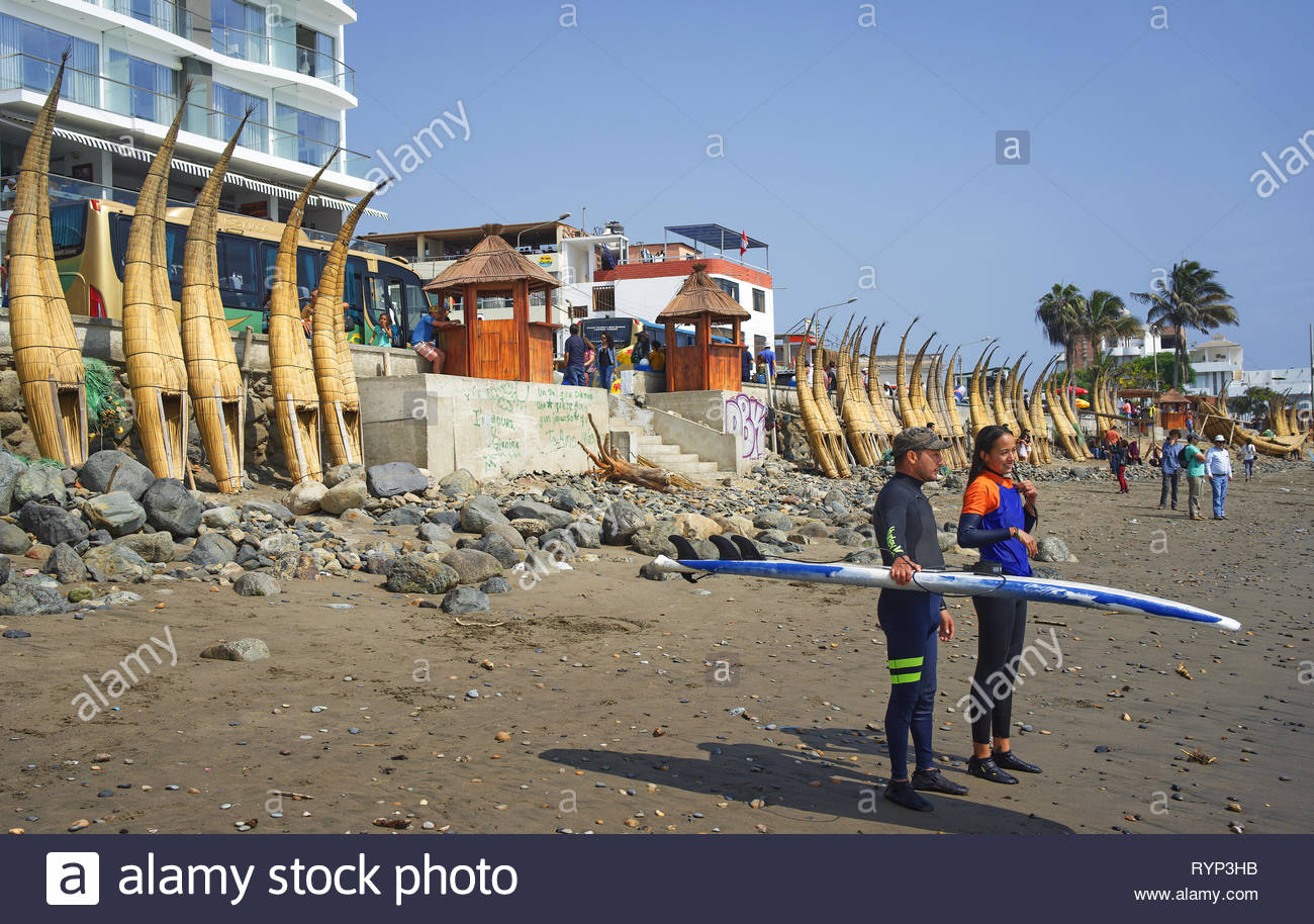 Surfer is waiting for the right wave at Huanchaco Beach Trujillo Peru - Stock Image