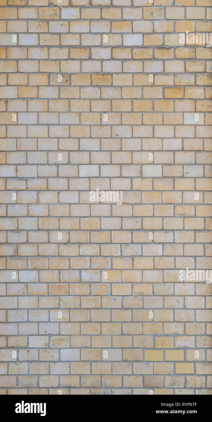 Full frame background of detailed old light yellow brick wall. Stock Photo