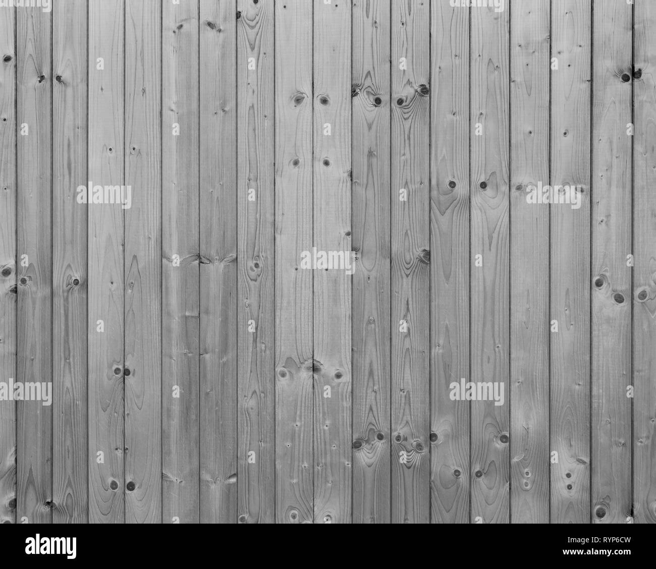 Full frame background of a new, clean and unpainted wood board wall in black and white. Stock Photo