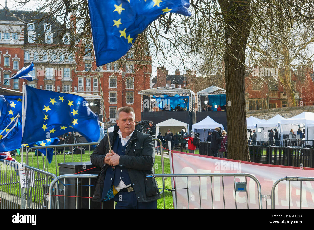 Westminster, London, UK. 14th Mar 2019. Demonstrator with the EU flag in front on the media circus outside the Houses of Parliament, on the 14th March 2019, the day that Parliament voted to delay Brexit Credit: Richard Barnes/Alamy Live News Stock Photo