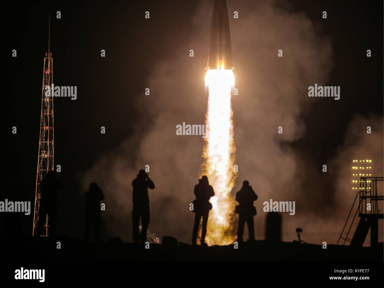 Kazakhstan. 14th Mar, 2019. KYZYLORDA REGION, KAZAKHSTAN - MARCH 14, 2019: A Soyuz-FG rocket booster carrying the Soyuz MS-12 spacecraft with Roscosmos cosmonaut Alexei Ovchinin, NASA astronauts Nick Hague and Christina H. Koch of the ISS Expedition 59/60 prime crew aboard lifts off to the International Space Station (ISS) from the Baikonur Cosmodrome. Sergei Savostyanov/TASS Credit: ITAR-TASS News Agency/Alamy Live News - Stock Image