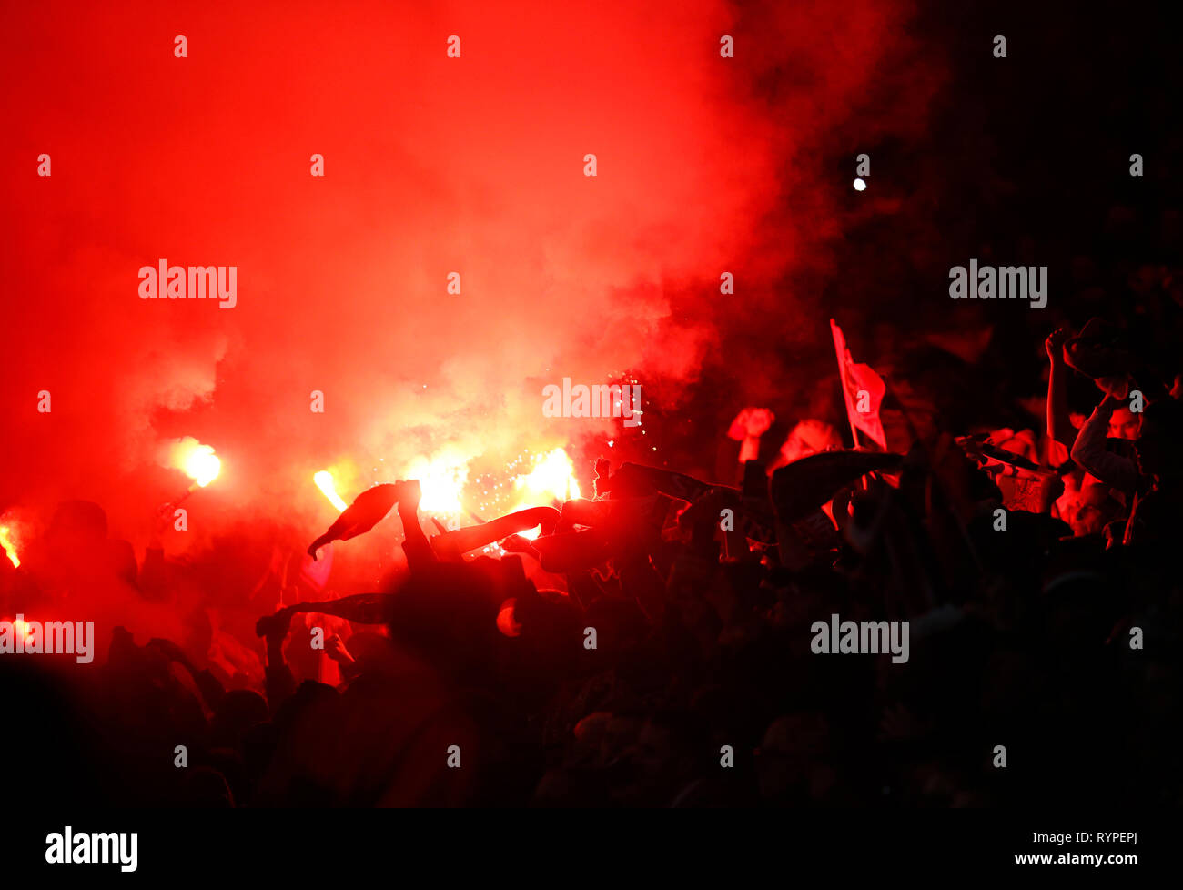 London, UK. 14th Mar, 2019. Flares during Europa League Round of 16 2nd Leg between Arsenal and Rennes at Emirates stadium, London, England on 14 Mar 2019. Credit: Action Foto Sport/Alamy Live News Stock Photo