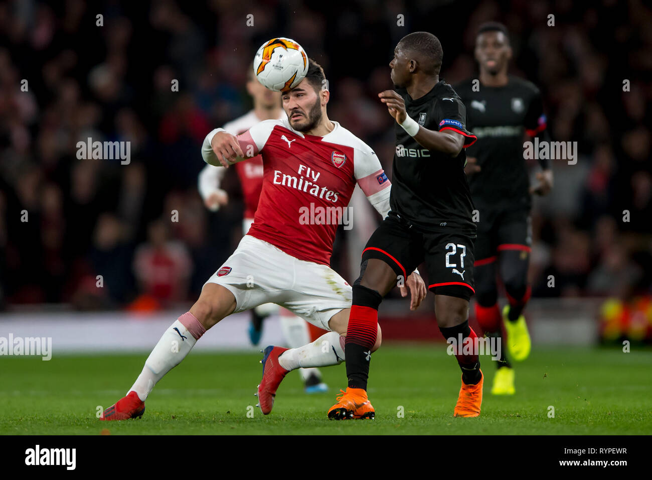London, UK. 14th Mar, 2019. Sead Kolašinac of Arsenal and Hamary Traoré of Rennes during the UEFA Europa League Round of 32 second leg match between Arsenal and Rennes at the Emirates Stadium, London, England on 14 March 2019. Photo by Salvio Calabrese. Editorial use only, license required for commercial use. No use in betting, games or a single club/league/player publications. Credit: UK Sports Pics Ltd/Alamy Live News - Stock Image