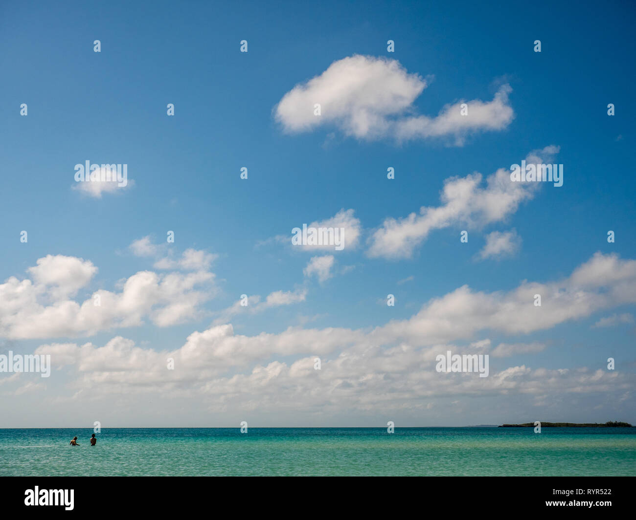 People Walking in Endless Caribbean Sea, Cocodimama Charming Resort, Governors Harbour, Eleuthera, The Bahamas, The Caribbean. - Stock Image