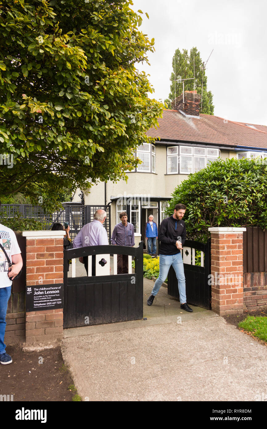 Visitors emerging from the childhood home of John Lennon, Menlove Avenue, Woolton, Liverpool. The museum to the former singer/songwriter and member of Stock Photo