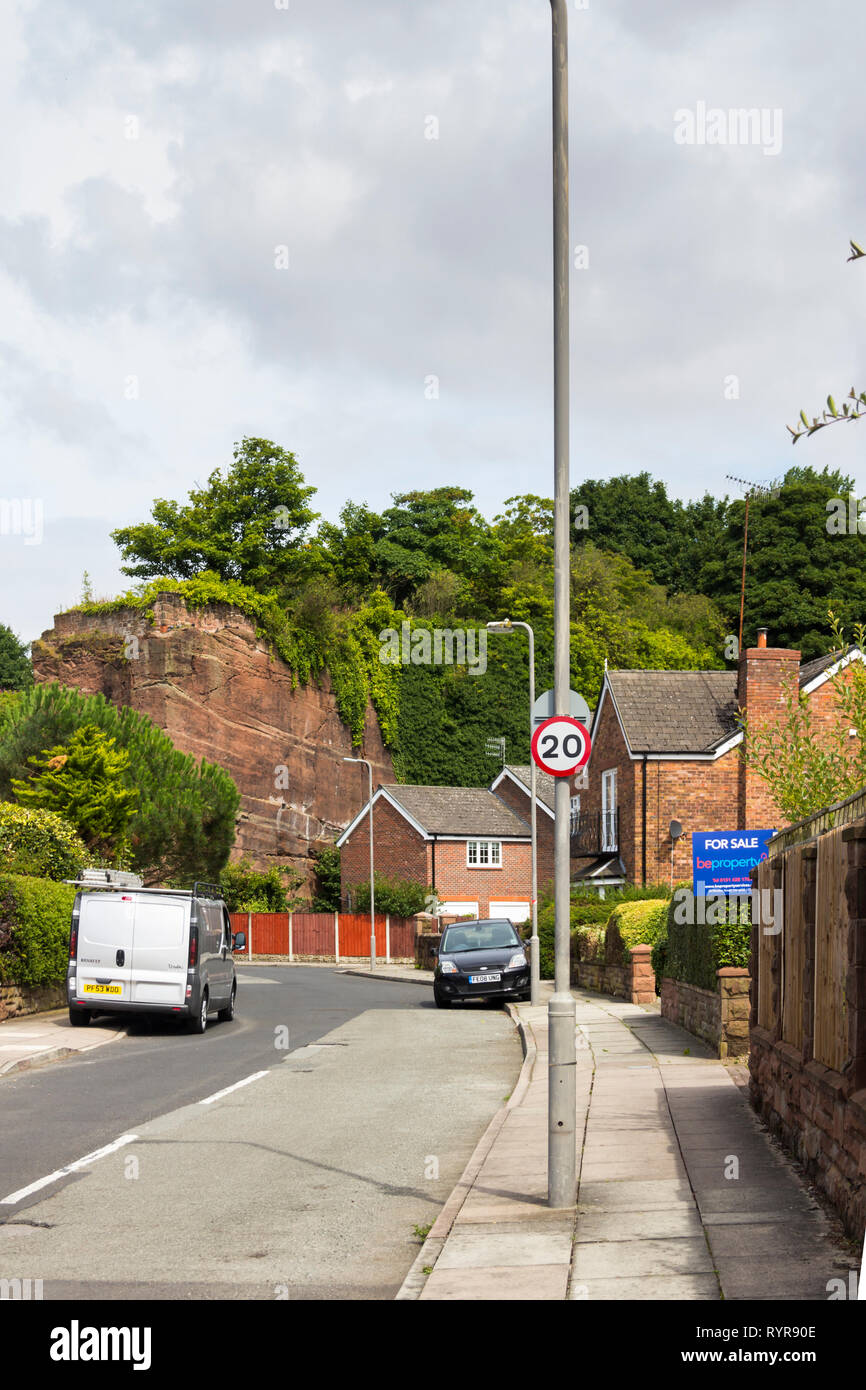The Old Quarry, a road in Liverpool with houses built in an old red sandstone quarry. Stone from this area was used to construct Liverpool cathedral. Stock Photo