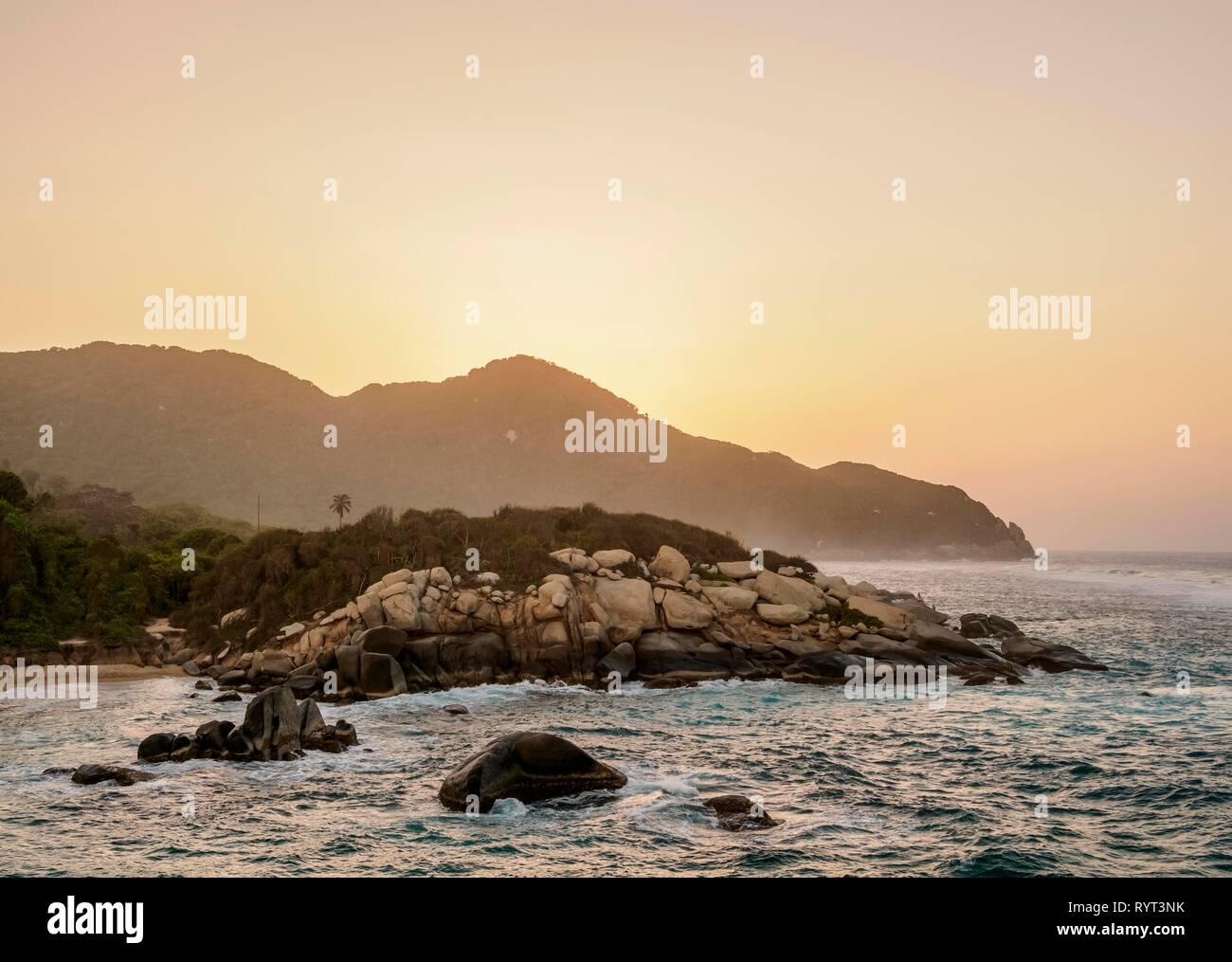 Rocky Coast of El Cabo San Juan del Guia at sunset, Tayrona National Natural Park, Magdalena Department, Caribbean, Colombia - Stock Image