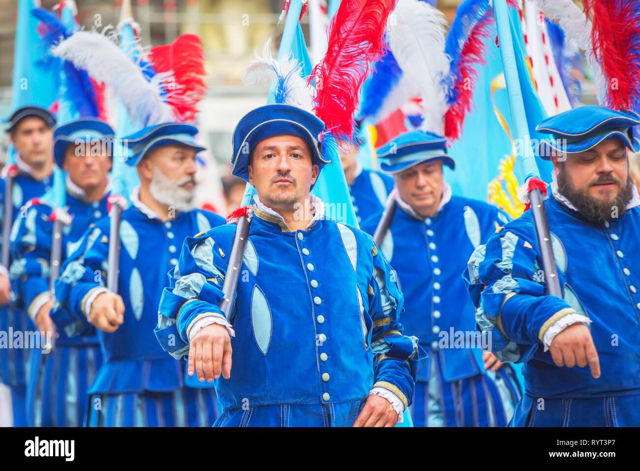 Participants in Calcio Storico Fiorentino festival marching through the city center in historical costumes, Florence, Tuscany Stock Photo