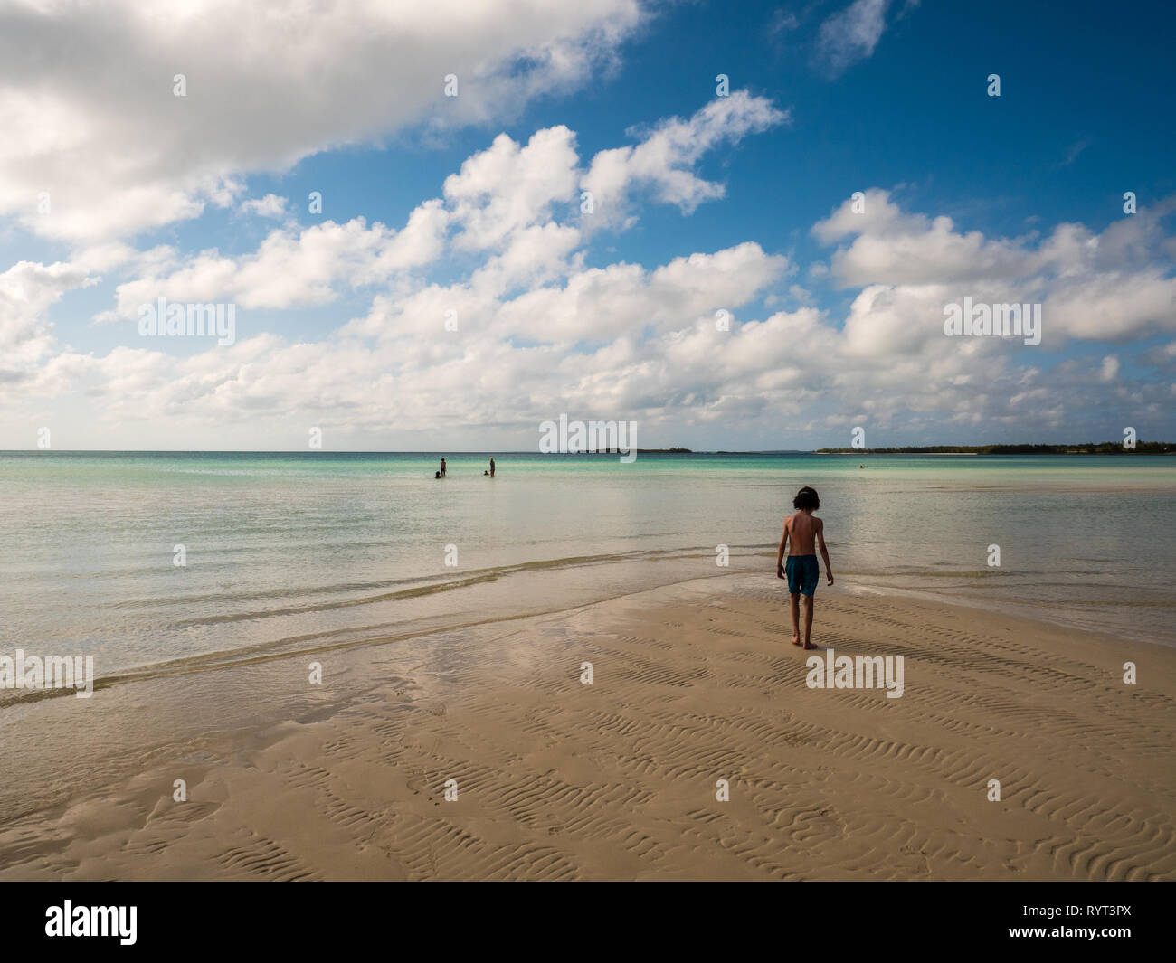 Young Boy on Sandy Beach, Caribbean Sea, Governors Harbour, Eleuthera, The Bahamas, The Caribbean. - Stock Image