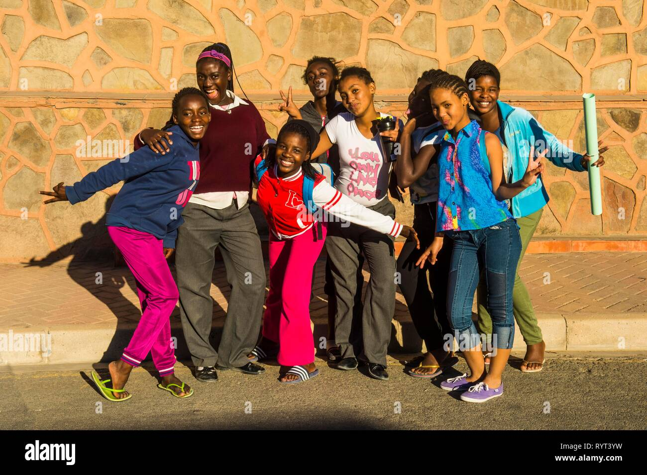 Children posing happily for the camera, Lüderitz, Namibia - Stock Image