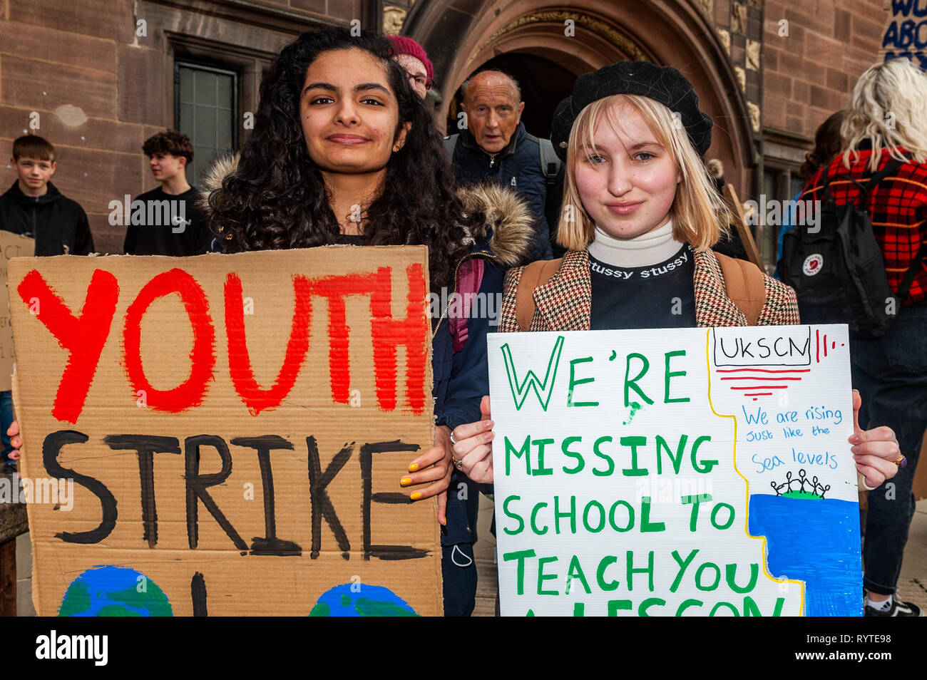 Coventry, West Midlands, UK. 15th March, 2019. A large crowd of protesters gathered outside Coventry Council House this morning with banners and placards in the latest climate change protest. Young people have taken to the streets of the UK in a global protest to try and bring about climate change.  At the protest were Shreya Virdee and Millie Hilditch-Gray, both from Coventry. Credit: Andy Gibson/Alamy Live News. - Stock Image