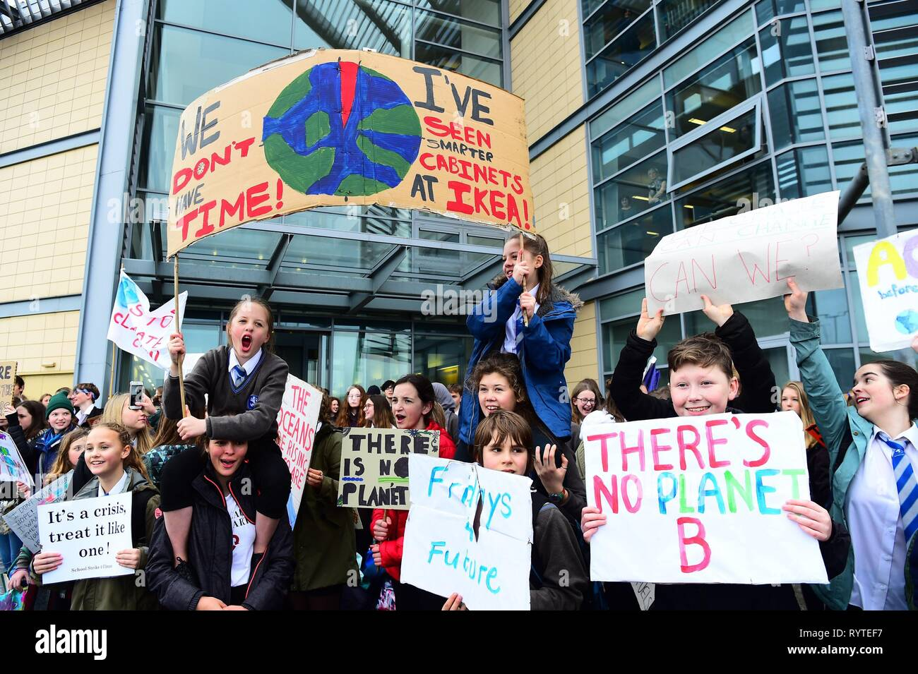 Aberystwyth Ceredigion Wales UK, Friday 15 March 2019. Pupils from local secondary schools taking part in the second UK-wide 'school strike 4 climate', protesting outside the offices of the local council in Aberystwyth Wales photo Credit: keith morris/Alamy Live News - Stock Image