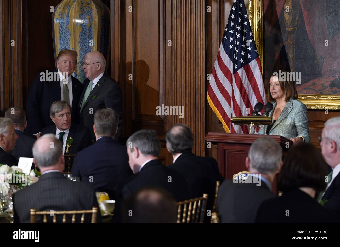 Washington, DC, USA. 14th Mar, 2019. United States President Donald J. Trump, left, and United States Senator Patrick Leahy (Democrat of Vermont), second left, listen to Speaker of the US House of Representatives Nancy Pelosi (Democrat of California), right, as she makes remarks during the Friends of Ireland luncheon with Leo Varadkar, Ireland's prime minister at the U.S. Capitol in Washington, DC, U.S., on Thursday, March 14, 2019. Credit: Olivier Douliery/Pool via CNP | usage worldwide Credit: dpa/Alamy Live News Stock Photo