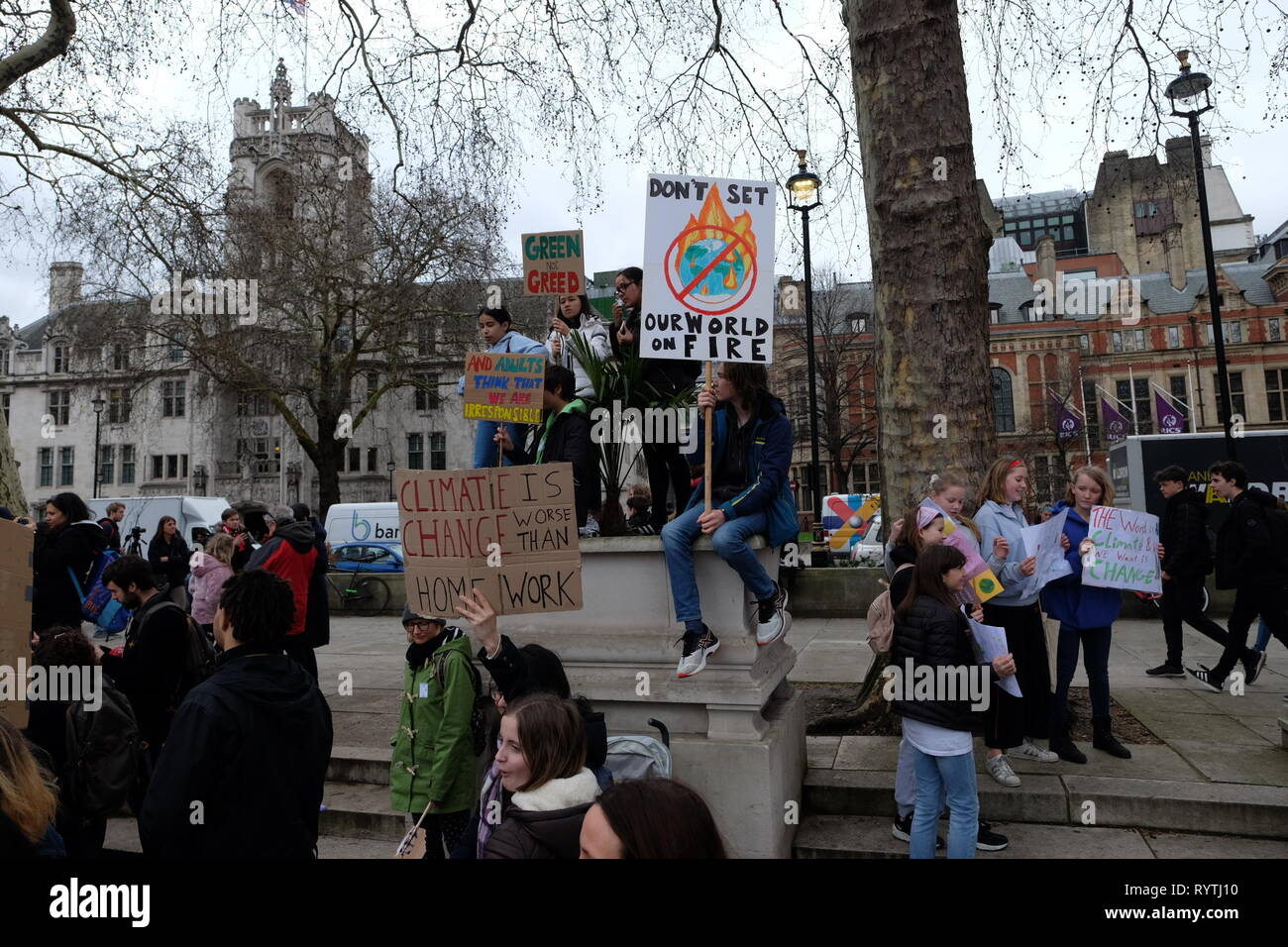 London, United Kinngdom - Friday 15 March 2019: Thousands of students and supporters gathered to picket on Parliament Square and The Departmnent for Business Energy and Industrial Strategy in support of Youth Strike 4 Climate. The #fridaysforfuture movement was started by Greta Thunberg, a 16 year-old Swedish Climate Activist and has gained momentum around the world. Stock Photo