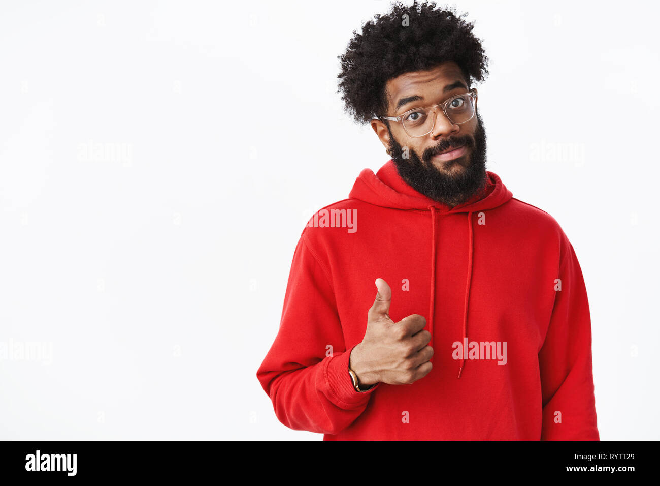 Nice work, proud of you. Portrait of supportive delighted african american male project manager in glasses with beard smiling in approval showing - Stock Image