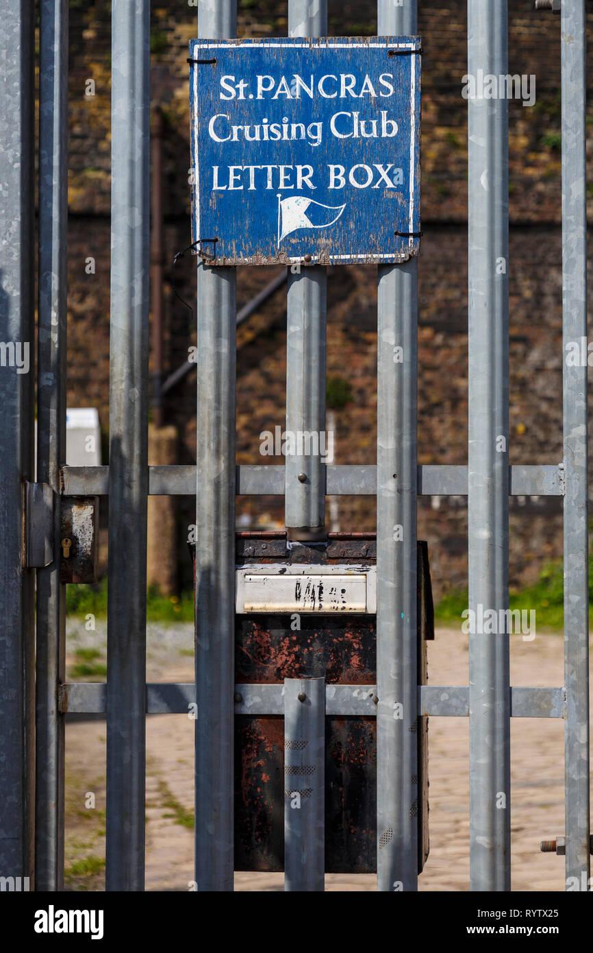 Notice attached to metal gateway saying 'St Pancras Cruising Club Letter Box', London, UK. - Stock Image