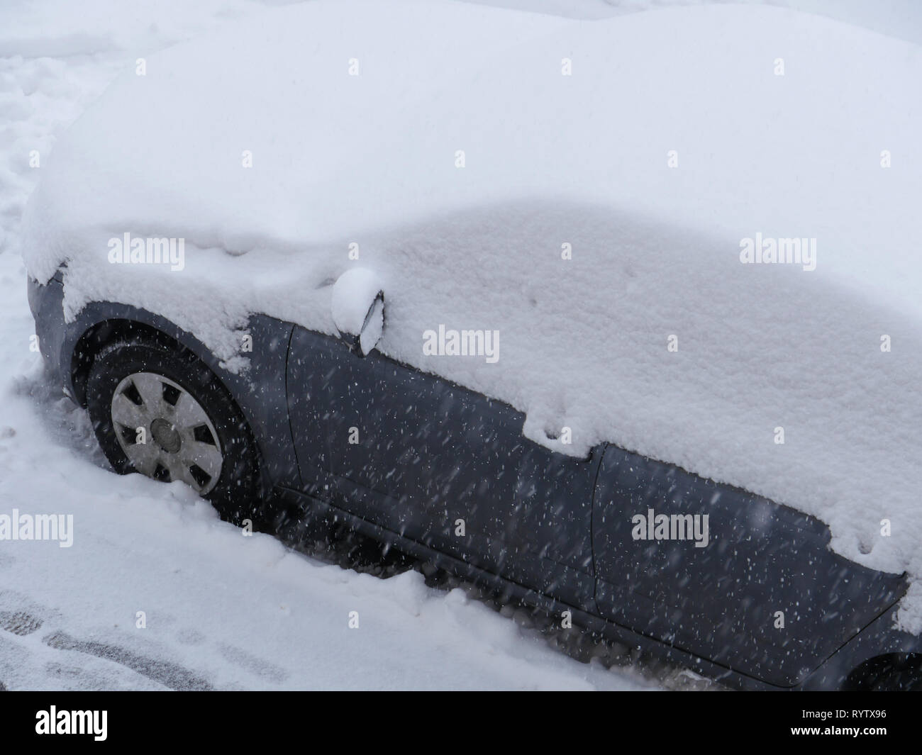 snowfall, passenger car covered with a thick layer of snow - Stock Image