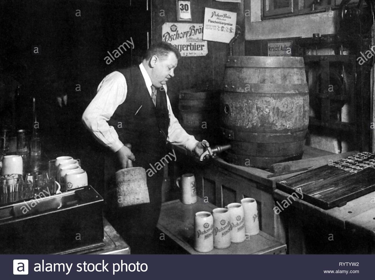 alcohol, beer, Toni Ferstl, host of the 'Donisl', tapping a barrel, Munich, Germany, circa 1930, Additional-Rights-Clearance-Info-Not-Available - Stock Image