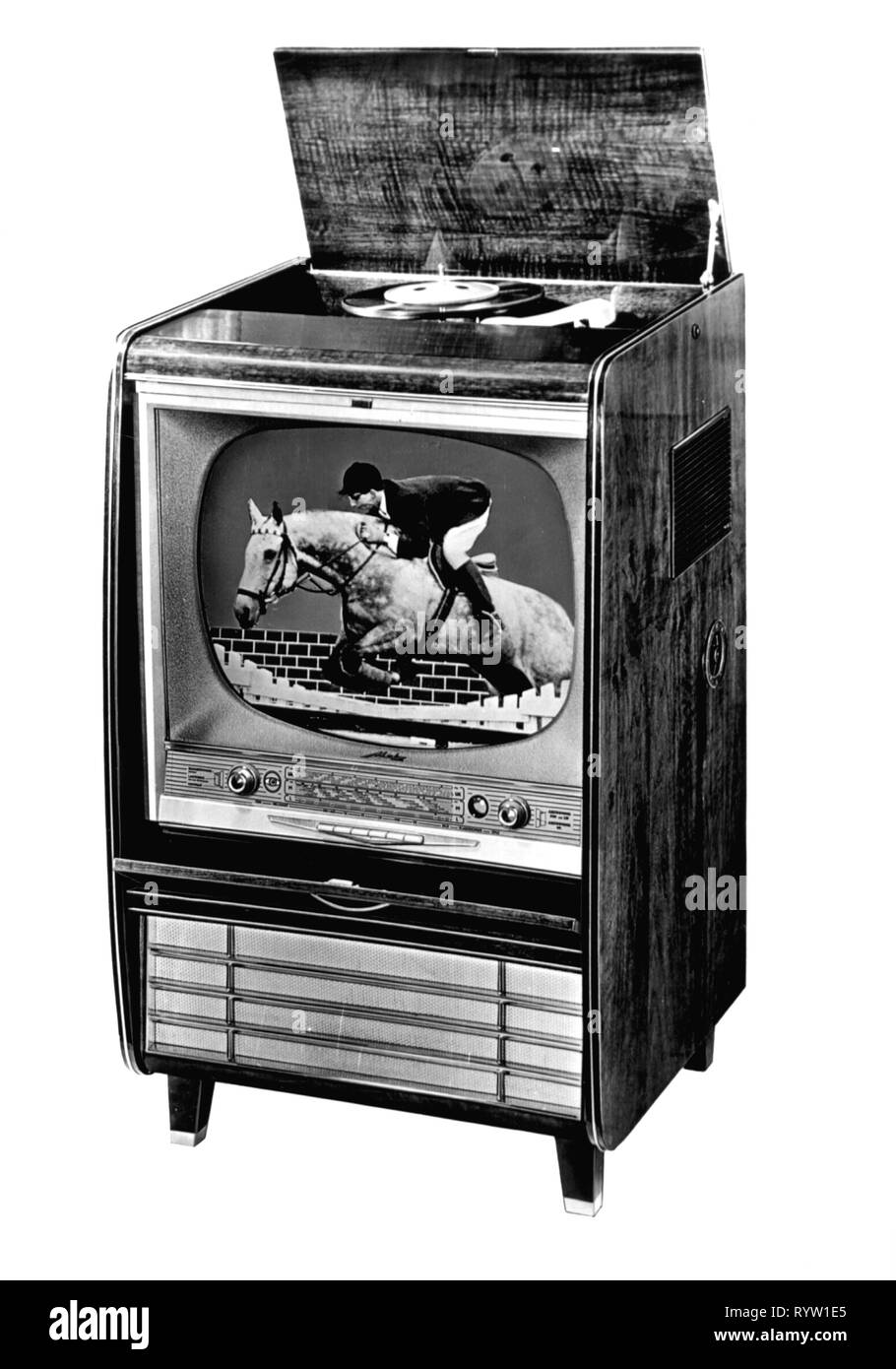 broadcast, television, television set Metz 1072, combined with record player and radio, Germany, 1958, telecast, telecasts, sports, riding, showjumping, telecommunications, telecommunication, consumer electronics, entertainment electronics, telecom, technics, industry, industries, Germany, 20th century, 1950s, television set, TV set, TV, television sets, TV sets, TVs, combining, combinating, combine, combinate, record player, record players, radio, radios, historic, historical, Additional-Rights-Clearance-Info-Not-Available - Stock Image