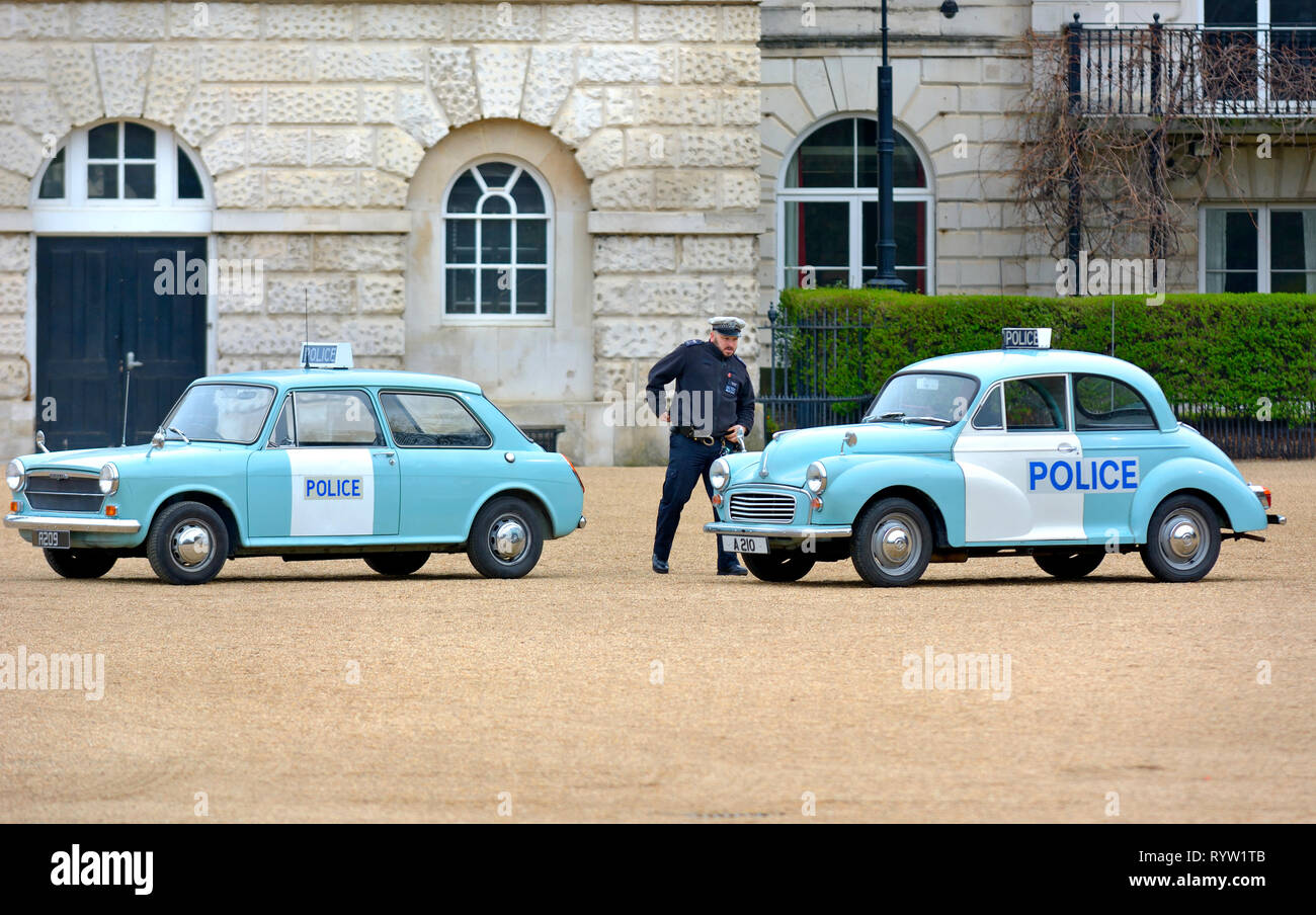 London, UK. 8th March 2019. Police Austin 1100 MKII (1973)and Morris Minor 1000 (1969) at a display of old Police Cars in Horse Guards Parade to coinc - Stock Image