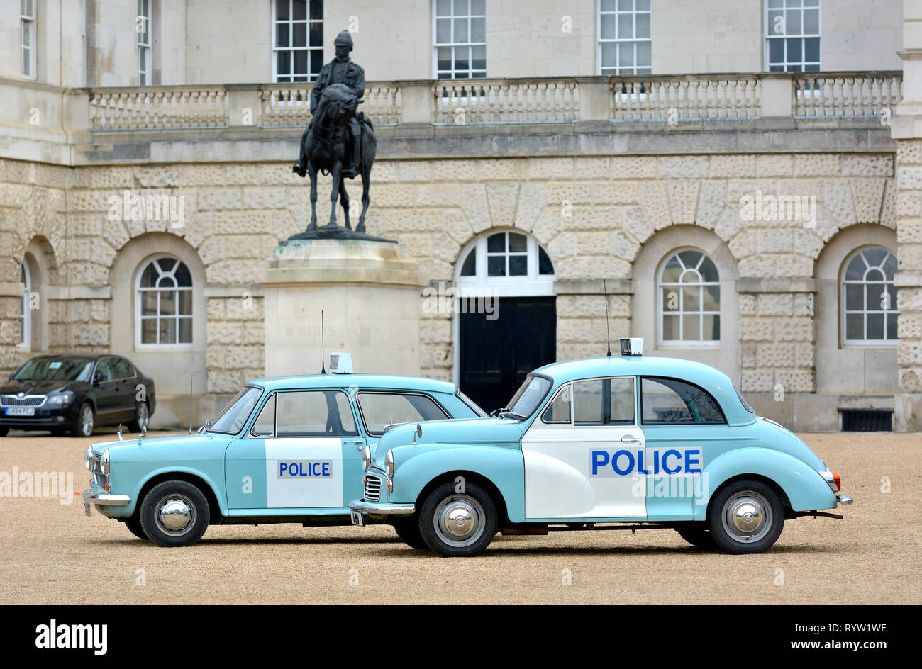London, UK. 8th March 2019. Police Austin 1100 MKII (1973) and Morris Minor 1000 (1969) at a display of old Police Cars in Horse Guards Parade to coin - Stock Image