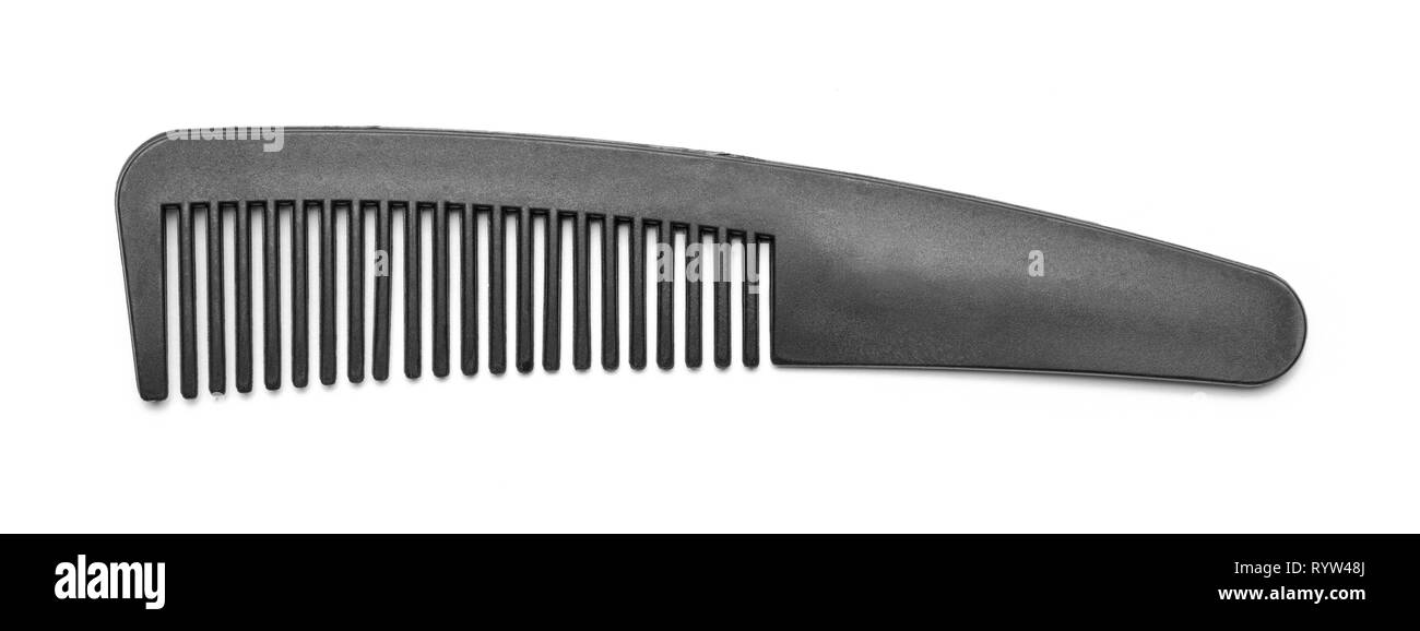 Black Plastic Comb Isolated on White Background. - Stock Image