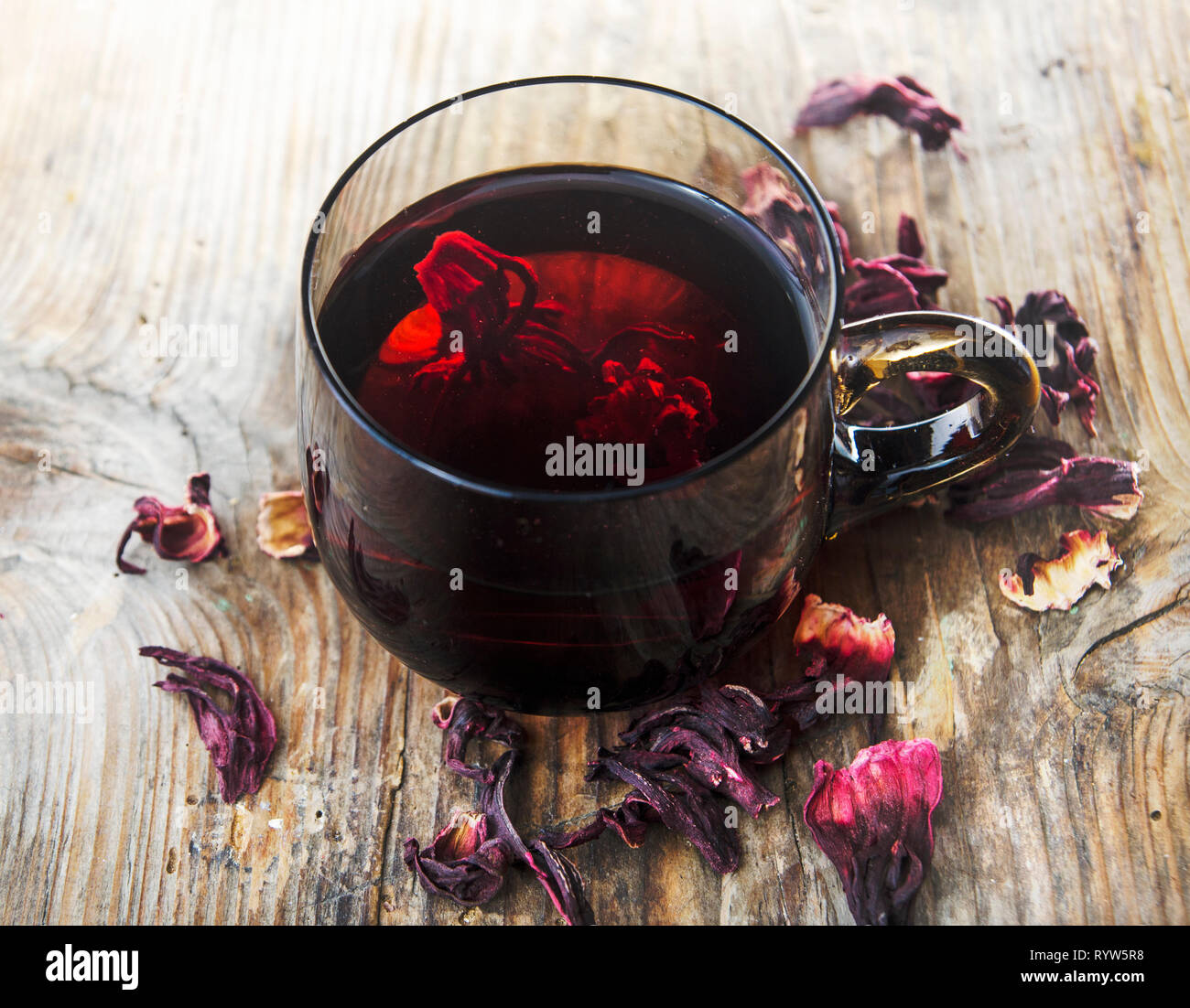 Hibiscus Tea In Teacup With Dry Hibiscus Flower Leaves Organic