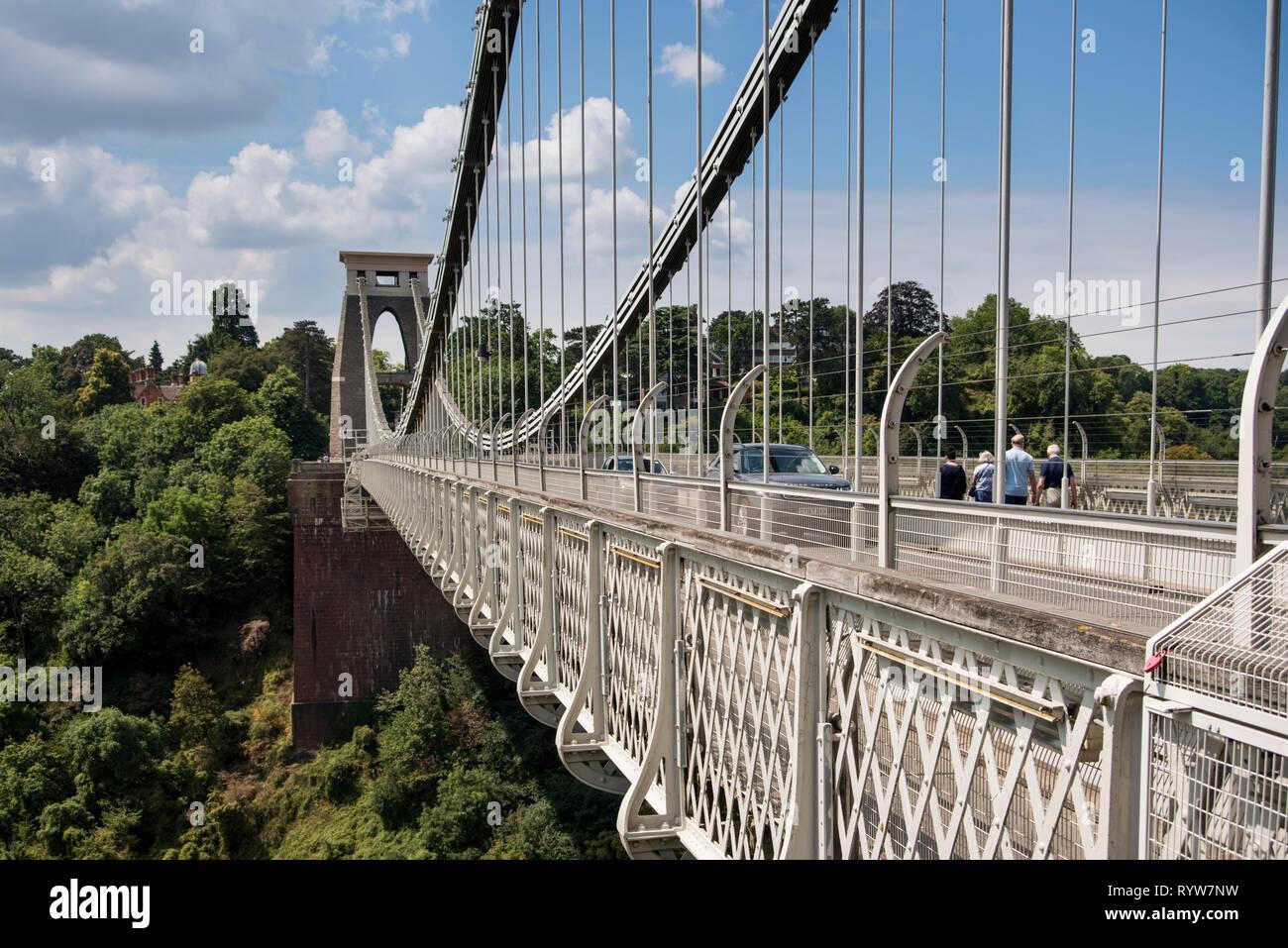Pedestrians and cars on the Clifton Suspension Bridge spanning Avon Gorge and River Avon, Bristol, UK Stock Photo