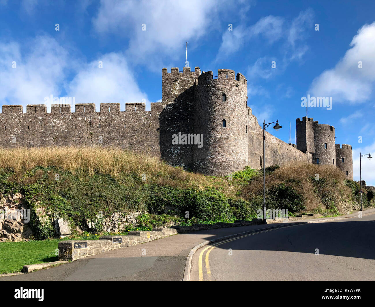 Pembroke Castle - medieval castle in Pembroke, Pembrokeshire, Wales. The castle was the original family seat of the Earldom of Pembroke. A Grade I lis Stock Photo
