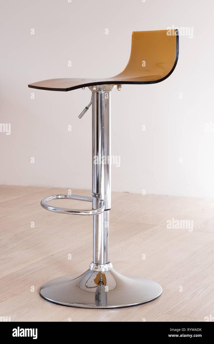 Modern kitchen bar stool with orange perspex seat Stock Photo   Alamy