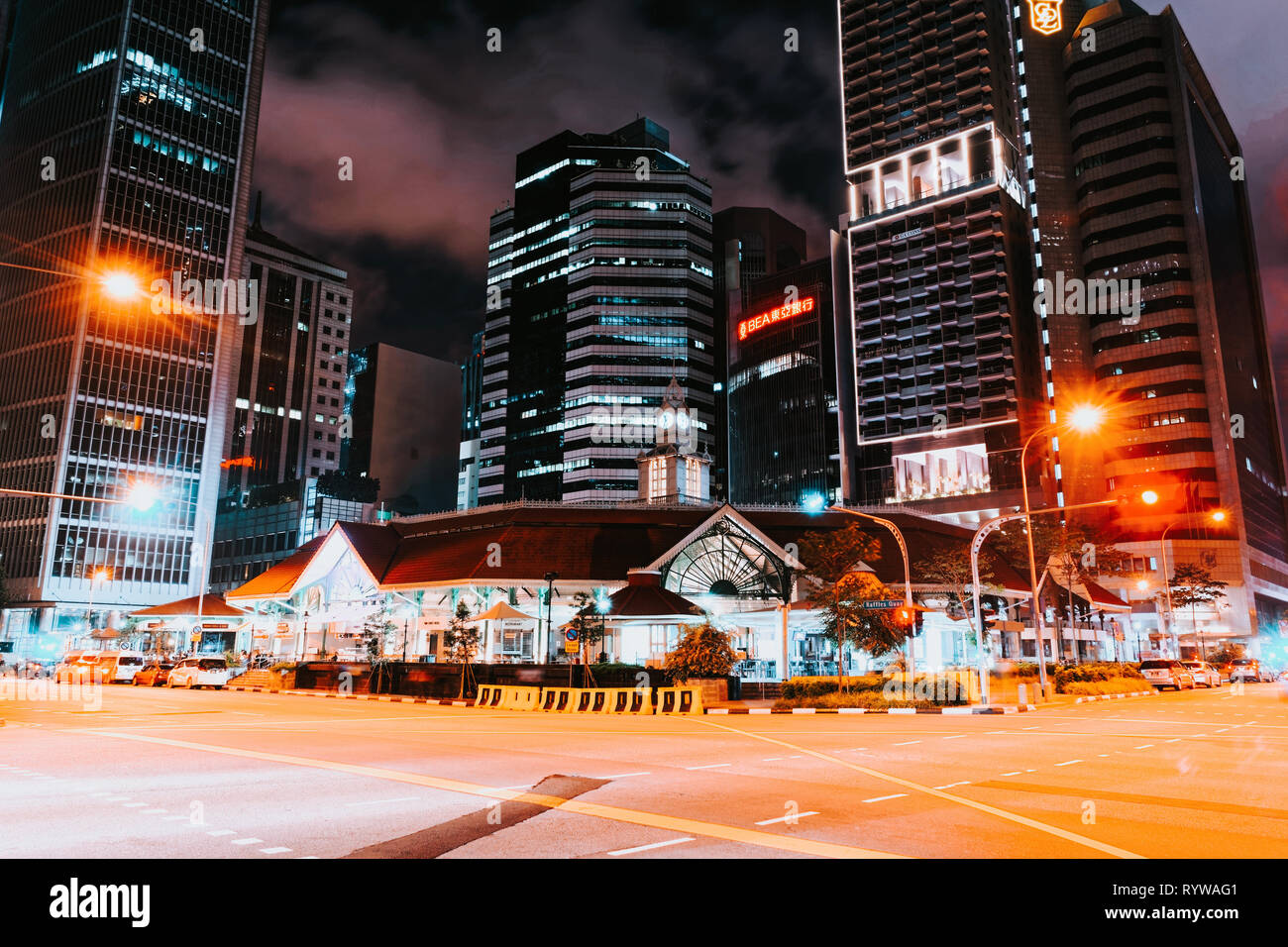 Singapore, Singapore - February 29, 2016: Telok Ayer Market and Singapore Stock Exchange building late in evening in Singapore - Stock Image