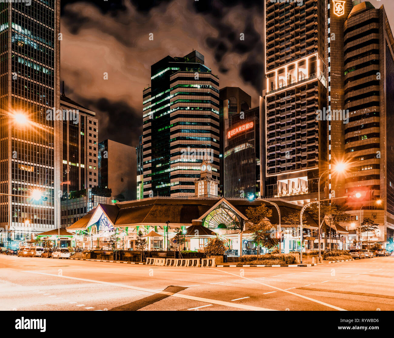 Singapore, Singapore - February 29, 2016: Skyscrapers and Telok Ayer Market at night. It is a food center in the Downtown Core of Singapore. - Stock Image