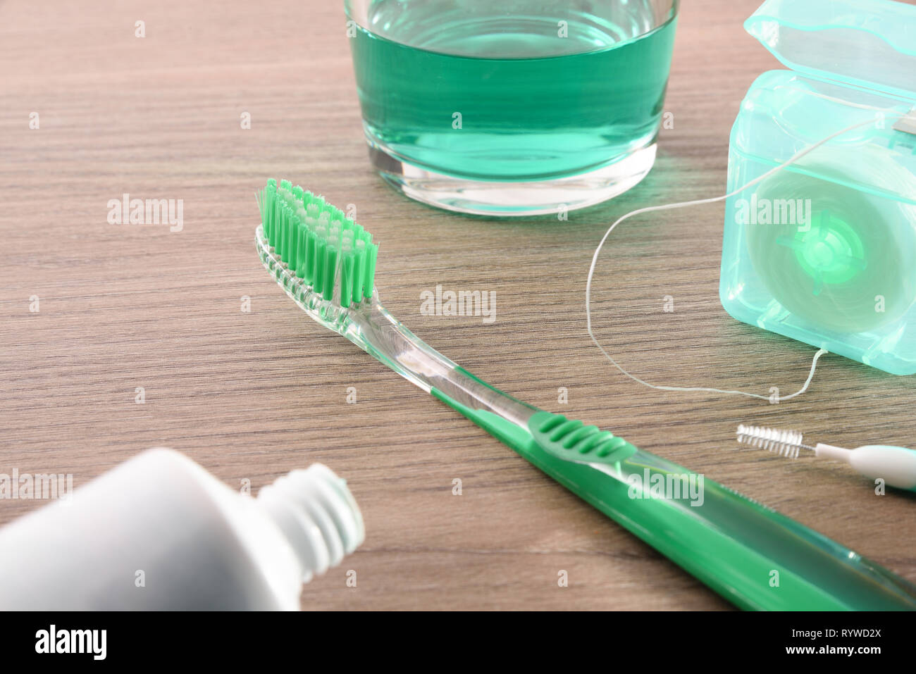 Concept of teeth cleaning at home with tools on wooden table close up . Horizontal composition. Elevated view - Stock Image