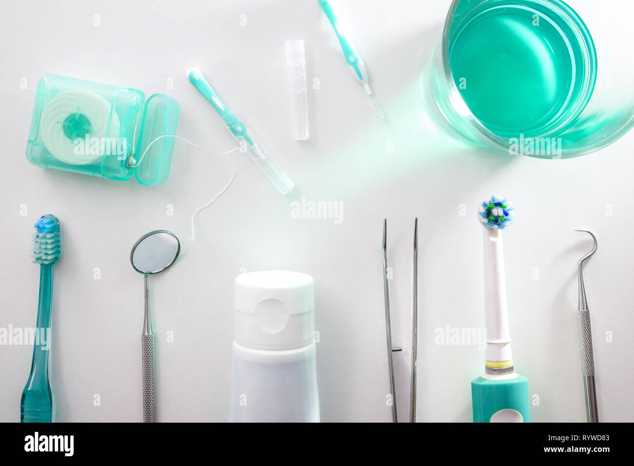 Tools for the maintenance and cleaning of the mouth on a white table.. Horizontal composition. Top view - Stock Image