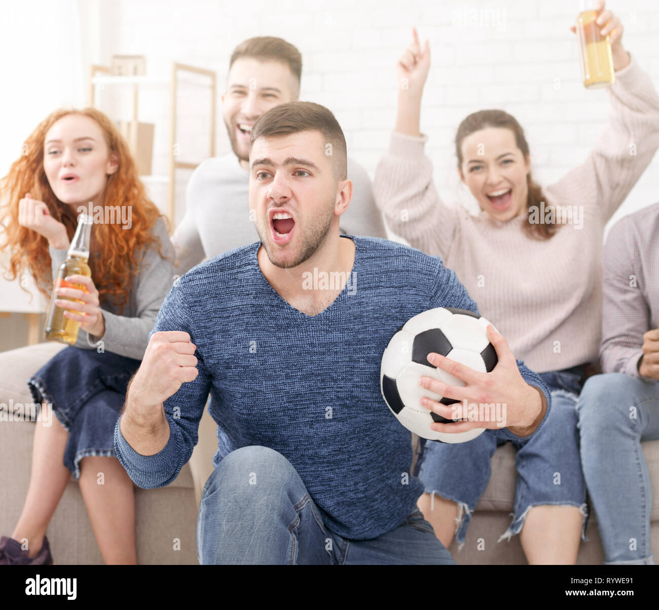 Football fans celebrating victory of favourite team Stock Photo