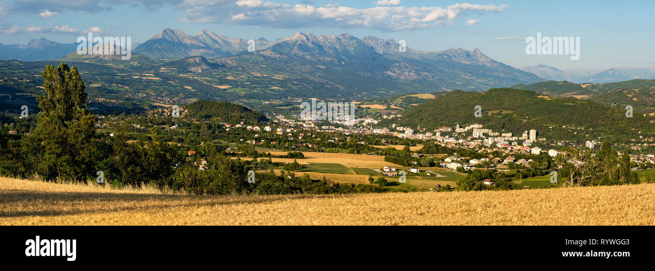Panoramic Summer view of the city of Gap in Hautes-Alpes. European Alps, France - Stock Image