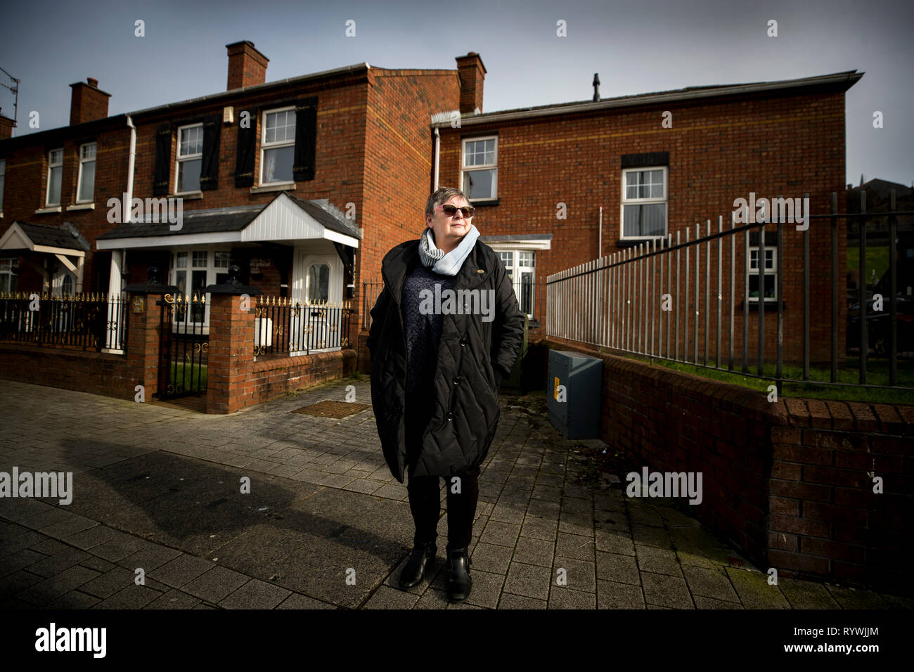 Jean Hegarty poses close to the spot where her brother Kevin McElhinney, 17, was shot dead on Bloody Sunday, to what was the front entrance of Rossville Flats in 1972. - Stock Image