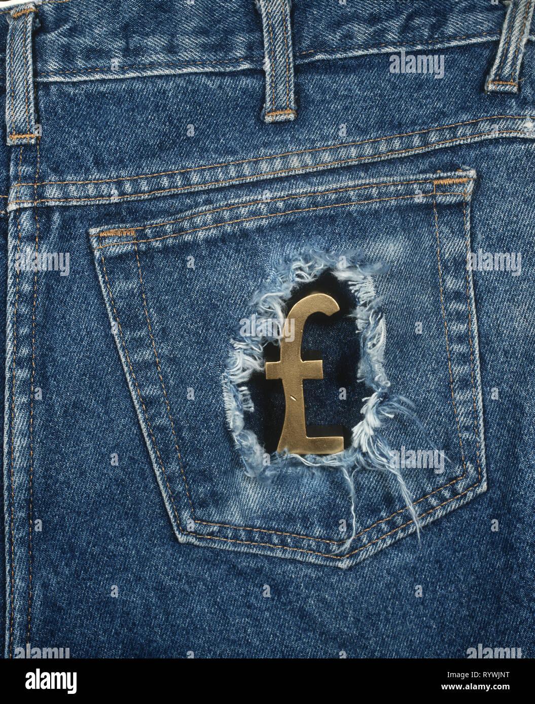 Pound sign burning a hole into jean pocket - Stock Image