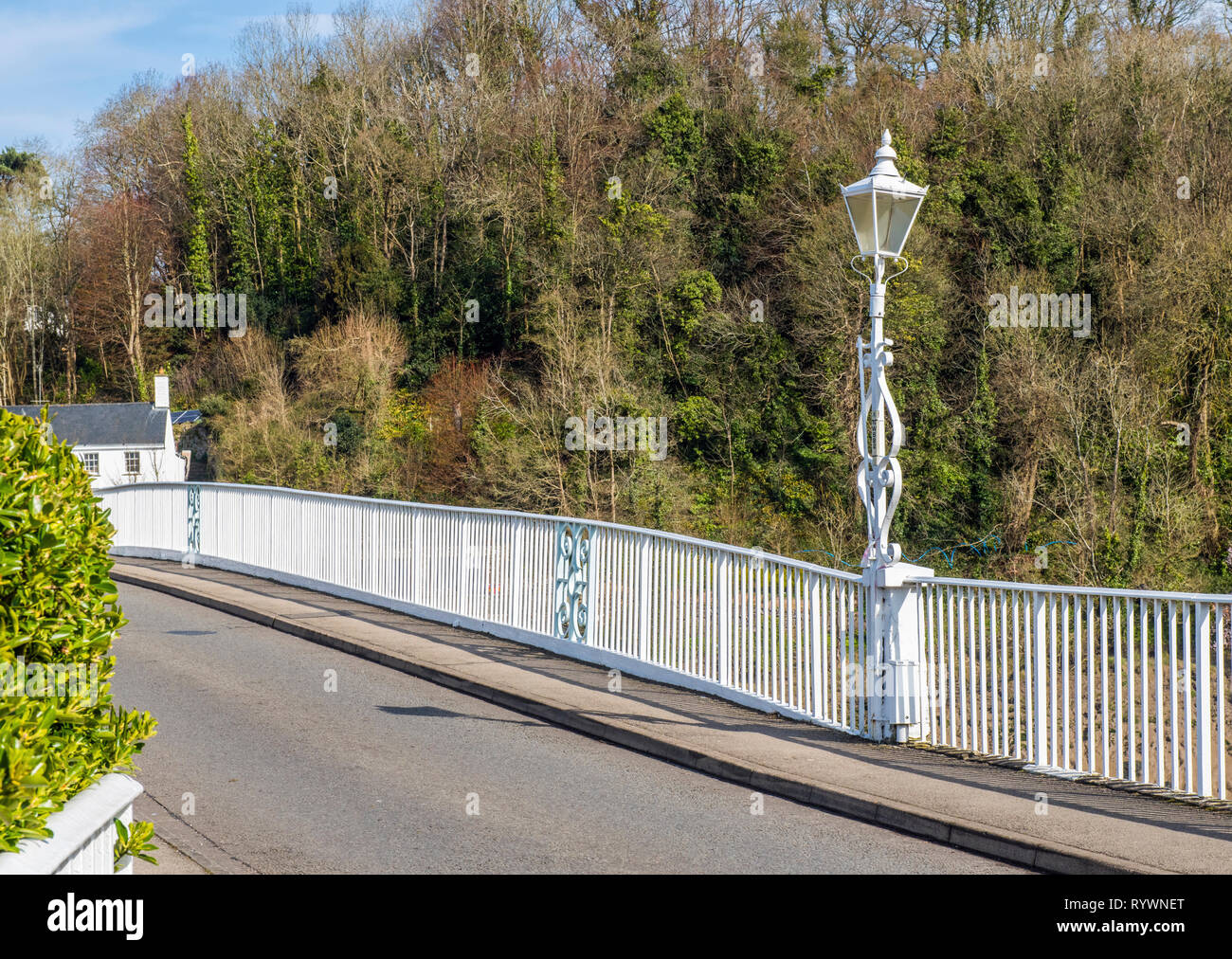 The old Iron Bridge separating Wales from England over the River Wye at Chepstow from the Wales side Stock Photo