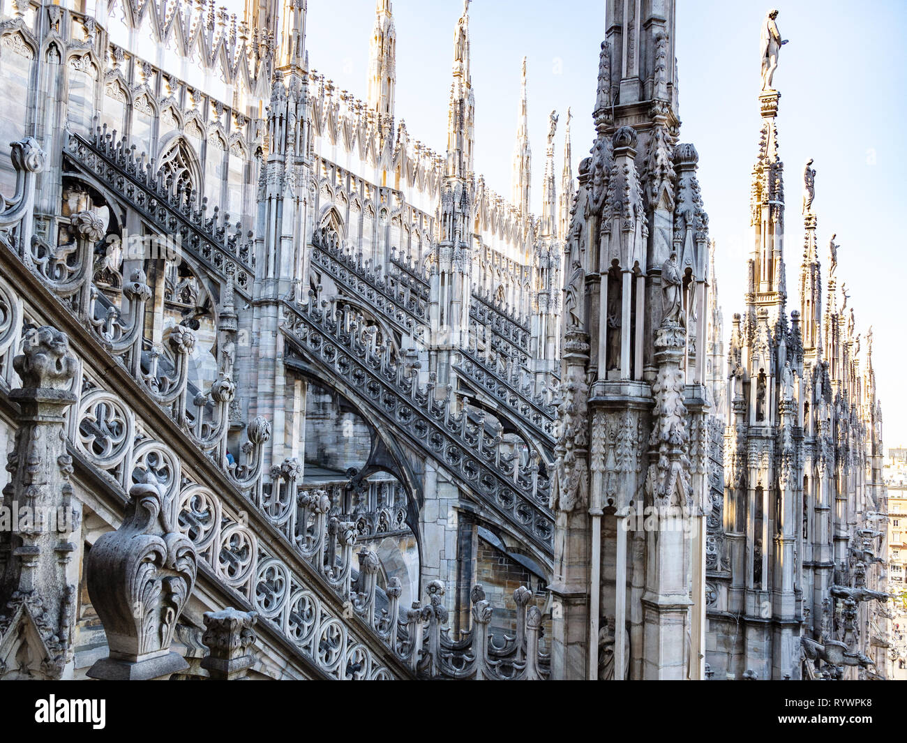 MILAN, ITALY - FEBRUARY 24, 2019: decorated roof of Milan Cathedral (Duomo di Milano) in Milan in morning. This Basilica is the largest church in Ital - Stock Image