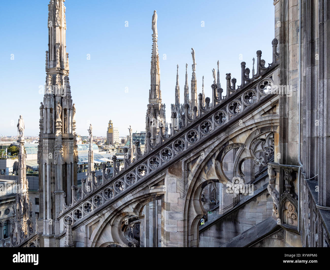 MILAN, ITALY - FEBRUARY 24, 2019: decor of roof of Milan Cathedral (Duomo di Milano) in Milan in morning. This Basilica is the largest church in Italy - Stock Image