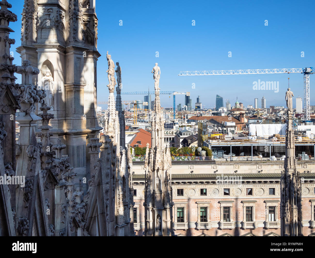 MILAN, ITALY - FEBRUARY 24, 2019: Milan city skyline from roof of Milan Cathedral (Duomo di Milano) in morning. This Basilica is the largest church in - Stock Image