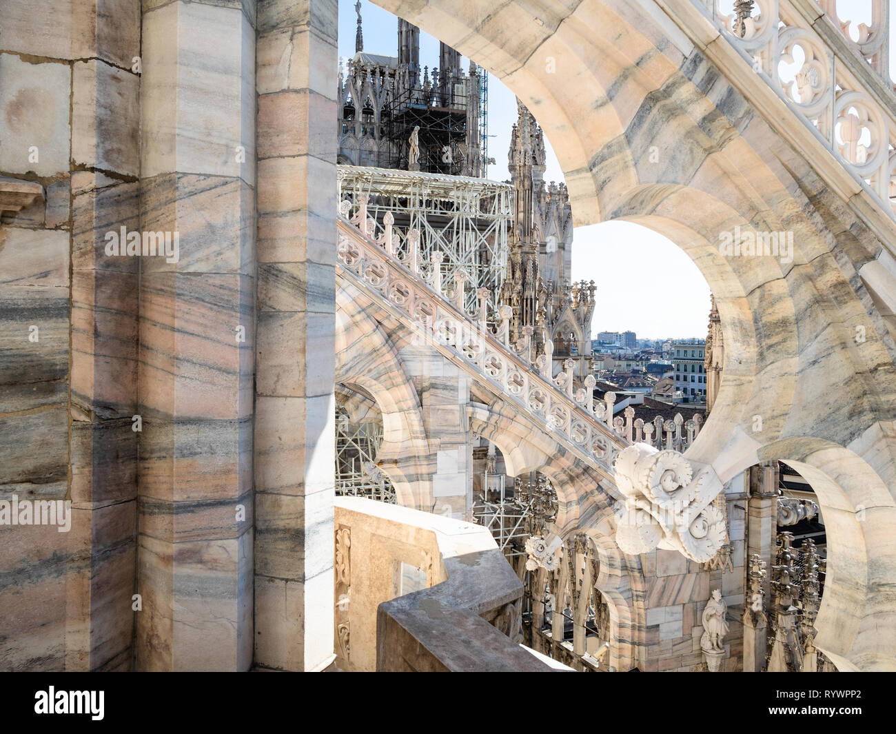 MILAN, ITALY - FEBRUARY 24, 2019: gothic decoration of Milan Cathedral (Duomo di Milano) roof in Milan in morning. This Basilica is the largest church - Stock Image