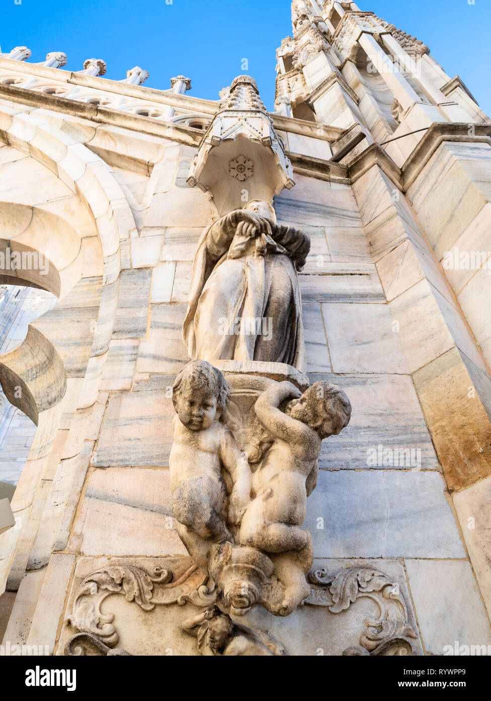 MILAN, ITALY - FEBRUARY 24, 2019: decorative figures on roof of Milan Cathedral (Duomo di Milano) in Milan in morning. This Basilica is the largest ch - Stock Image