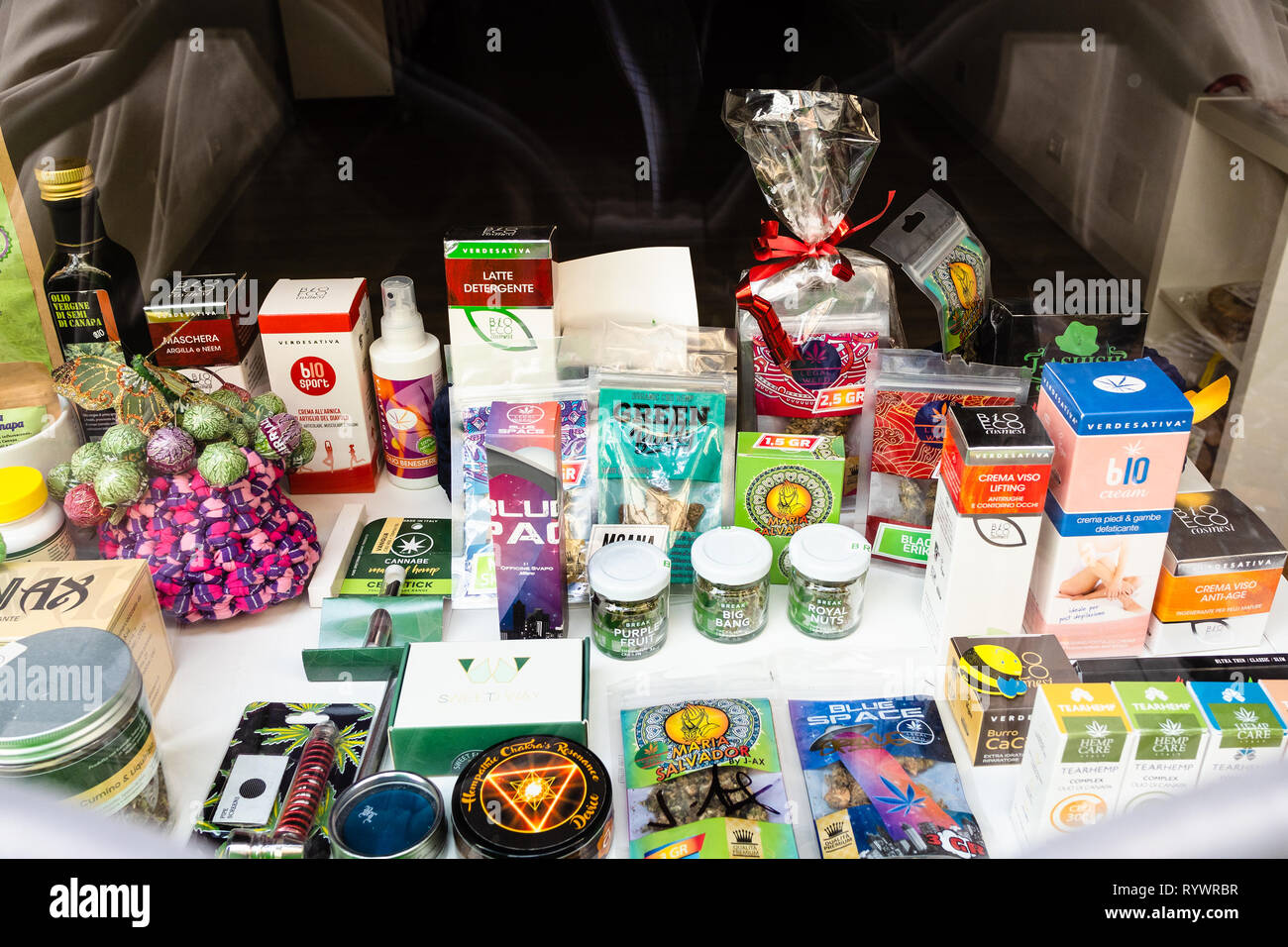 BERGAMO, ITALY - FEBRUARY 26, 2019: window of bio store with various legal medicinal herbs and cannabis products in Lower Town of Bergamo city, Lombar - Stock Image