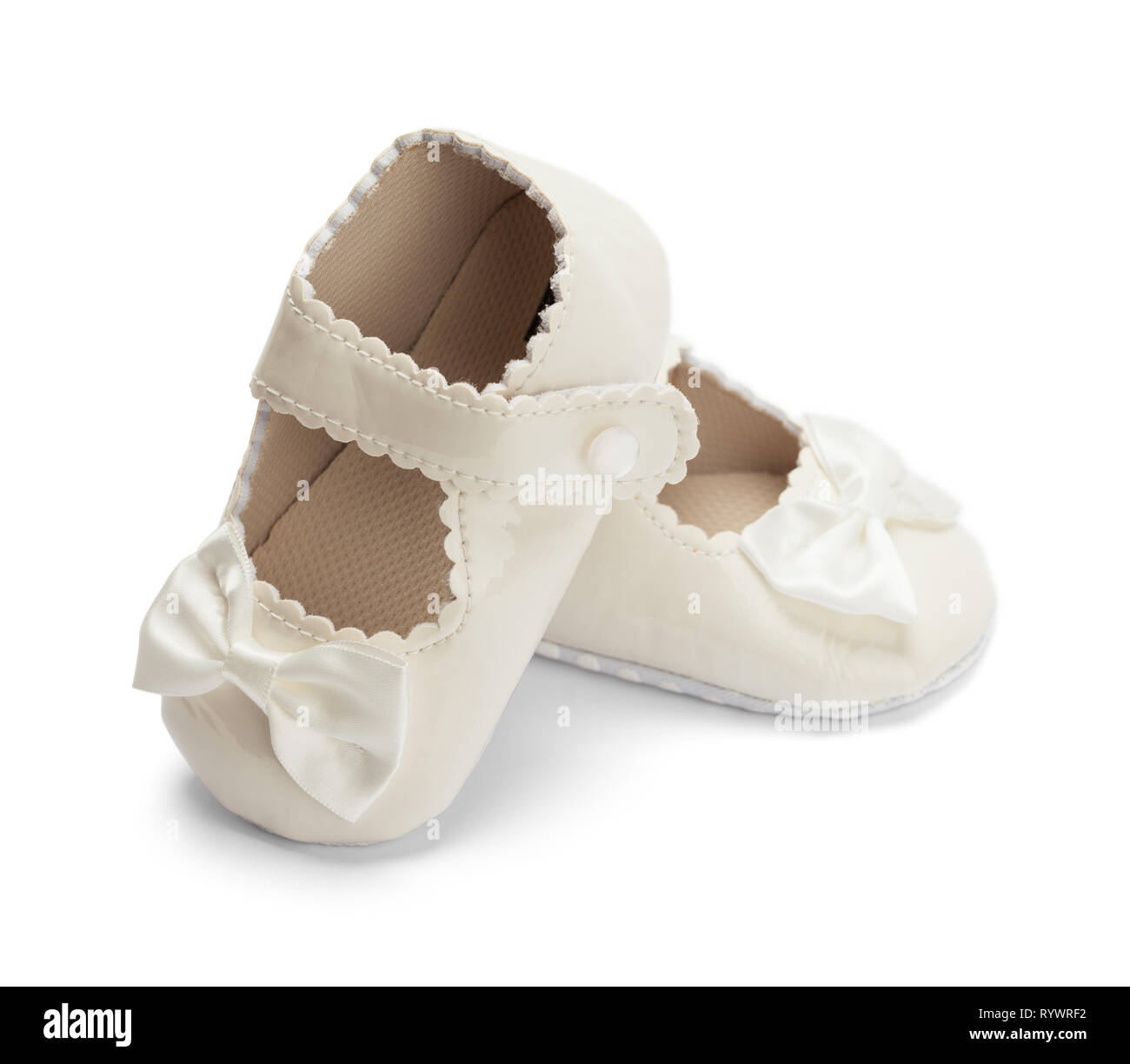 Pair of Girls Baby Shoes With Bows Isolated on White. - Stock Image