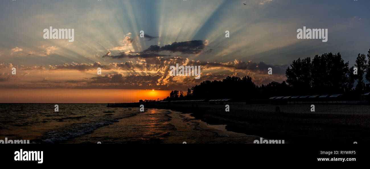 Fascinating clouds flashing by bright sunlight over the Black Sea seaside view in Lazurne, Kherson region - Stock Image