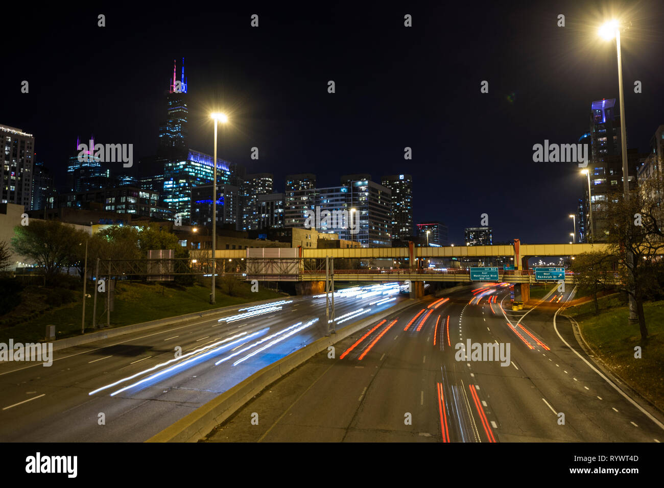 Long exposure shot of the traffic on one of Chicago's interstates. - Stock Image