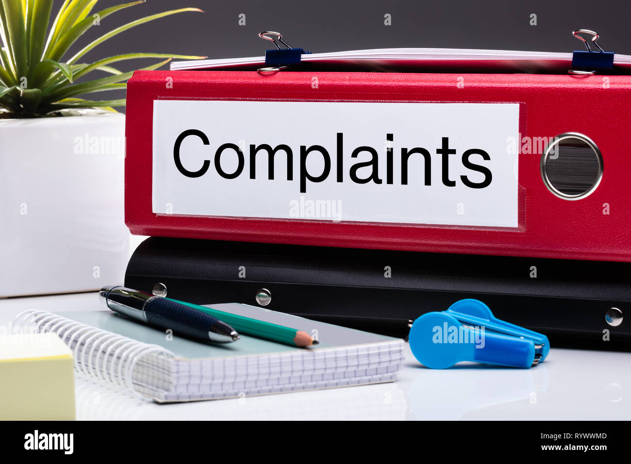 Close Up Of Compliance Folder And Office Supplies On Office Desk Stock Photo