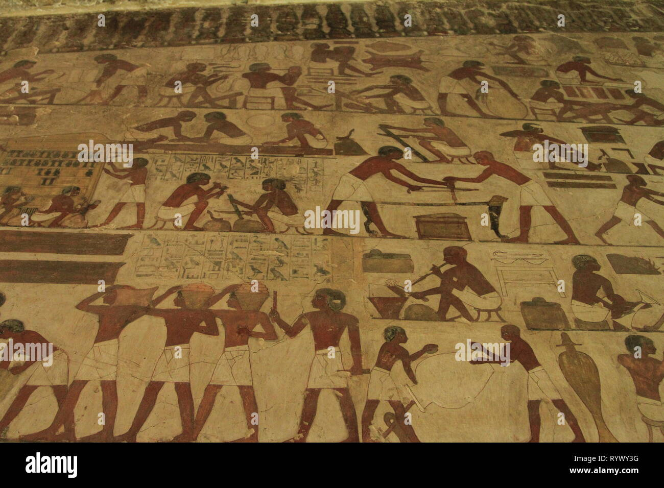 Painting showing everyday scenes, such as carpentry, woodworking, hauling grain, in Ancient Egypt, Rekhmire's tomb, Deir el-Medina, West Bank, Luxor - Stock Image